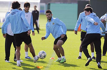 Manchester City's Aguero fights for the ball during a practice session at the club's Carrington training complex