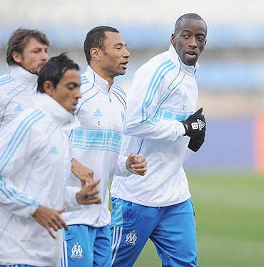 Marseille players warm up during the training session