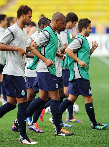 FC Porto players excercise during a training session