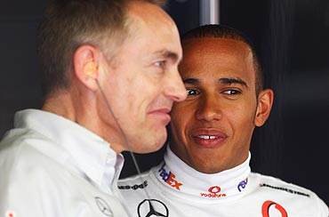 Lewis Hamilton (right) of McLaren Mercedes and his Team Principal Martin Whitmarsh