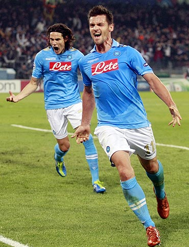 Napoli's Christian Maggio (right) celebrates with teammate Edinson Cavani after scoring against Bayern Munich