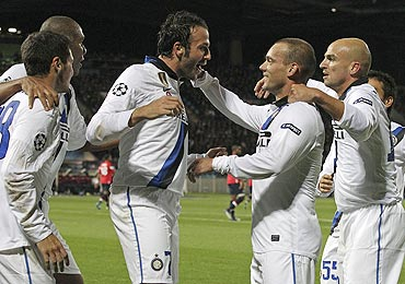 Inter Milan's Giampaolo Pazzini (centre) is congratulated by teammates after his goal against Lille