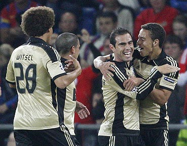 Benfica's Bruno Cesar (centre) celebrates with teammates after scoring against FC Basel