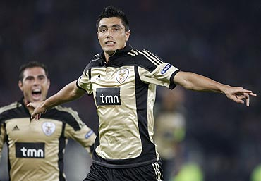 Benfica's Bruno Oscar Cardozo (right) celebrates after scoring against FC Basel