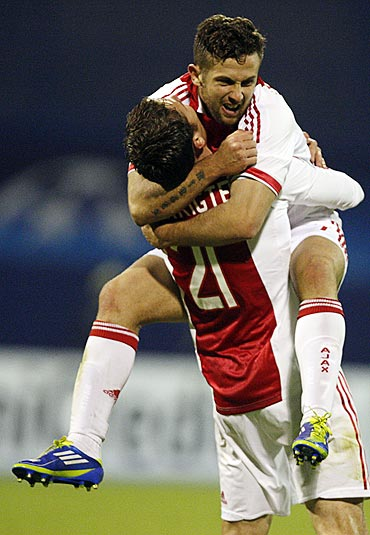 Derk Boerrigter and Miralem Sulejmani (top) of Ajax Amsterdam celebrate after scoring against Dinamo Zagreb