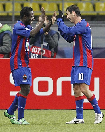 CSKA Moscow's Seydou Doumbia celebrates with teammate Alan Dzagoev after scoring against Trabzonspor