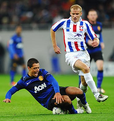 Manchester United's Javier Hernandez is fouled by Gabriel Giurgiu of FC Otelul Galati
