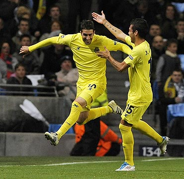 Villarreal's Cani (left) celebrates with Jose Catala after scoring against Manchester City