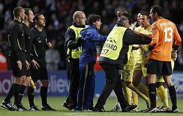 Villarreal players argue with match officials and stewards after their match against Manchester City
