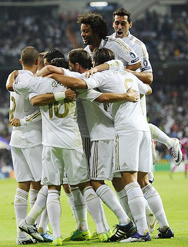 Real Madrid's players celebrate after Karim Benzema scored against Olympique Lyon