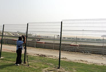 A Red Bull goes uphill towards Turn 3, as seen from the Picnic Stands, North