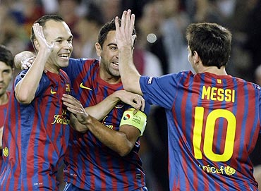 Barcelona's Andres Iniesta (left) is congratulated by teammates after scoring against Viktoria Plzen
