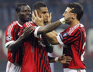 AC Milans's Kevin-Prince Boateng (centre) celebrates with his teammates Taye Taiwo (left) and Daniele Bonera