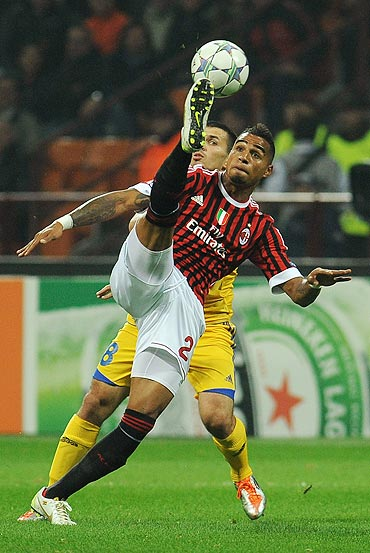 AC Milan's Kevin-Prince Boateng is challenged by Aleksandr Volodko of Borisov