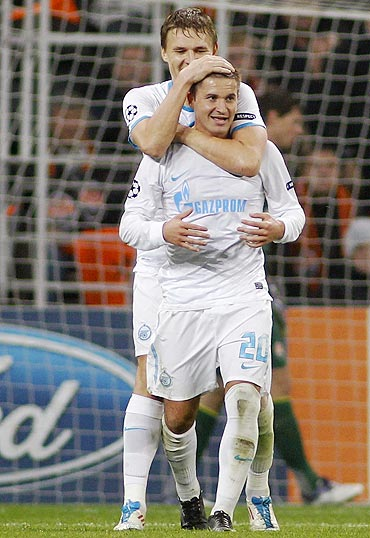 Zenit St. Petersburg's Viktor Fayzulin (front) celebrates with teammate Evgeni Bashkirov after scoring against Shakhtar Donetsk