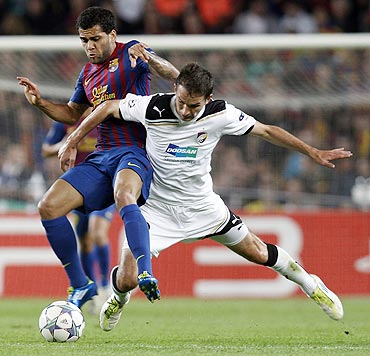 Barcelona's Daniel Alves (left) is challenged by Viktoria Plzen's Marek Bakos