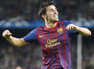 Barcelona David Villa celebrates after scoring against Viktoria Plzen