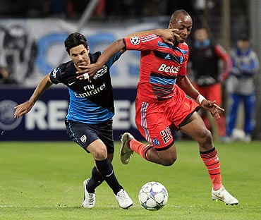 Olympique Marseille's Andre Ayew (right) challenges Arsenal's Mikel Arteta