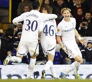 Tottenham Hotspur's Roman Pavlyuchenko (right) celebrates with teammates after scoring against Rubin Kazan