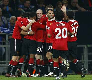 Manchester United players celebrate after winning a match