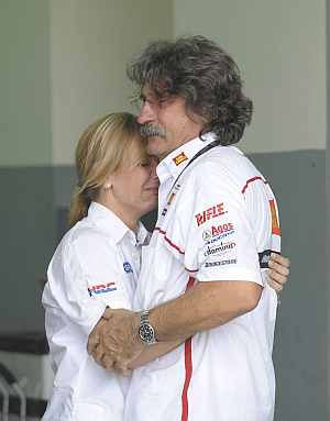Paolo (R), the father of Marco Simoncelli of Italy, is consoled inside the pit