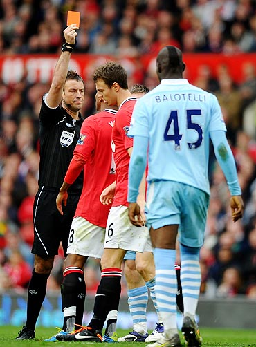 Jonny Evans recieves a red card during his game against Manchester City