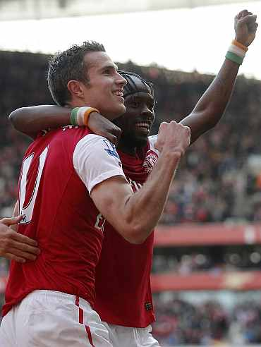 Robin van Persie celebrates with teammate after scoring against Stoke City