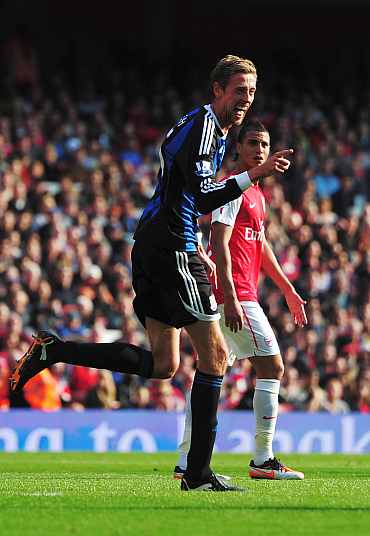 Peter Crouch smiles after scoring against Arsenal