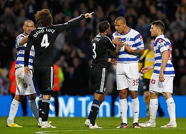Ashley Cole of Chelsea argues with Anton Ferdinand of Queens Park Rangers (right) during their EPL match on Sunday