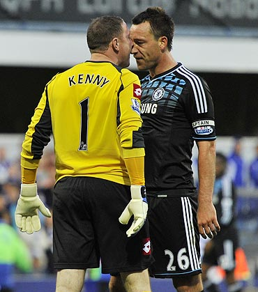 Queen's Park Rangers's goalkeeper Paddy Kenny (left) and Chelsea's John Terry confront each other during their EPL match on Sunday