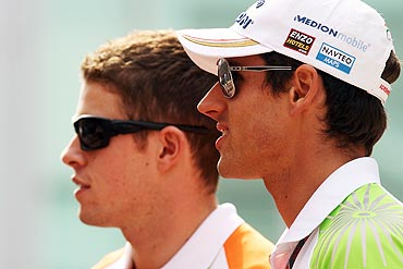 Force India drivers Paul di Resta and Adrian Sutil (right)