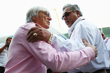 F1 supremo Bernie Ecclestone talks with Force India Chairman Vijay Mallya (right)
