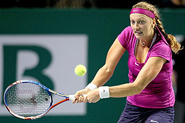 Petra Kvitova of the Czech Republic returns a shot to Caroline Wozniacki of Denmark