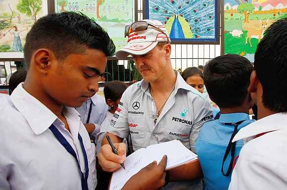 Michael Schumacher signing autograpghs for fans at the Buddh International Circuit
