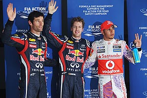 Pole sitter Sebastian Vettel (centre) of Red Bull celebrates with second placed Mark Webber (L) of Red Bull Racing and third placed Lewis Hamilton (R) of McLaren after qualifying for the Indian Formula One Grand Prix at the Buddh International Circuit on Saturday