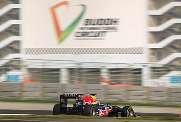 Sebastian Vettel drives en route to pole position during qualifying at the Indian Formula One Grand Prix