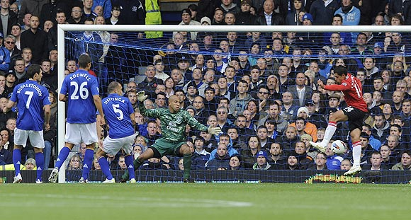 Manchester United's Javier Hernandez (right) shoots to score against Everton