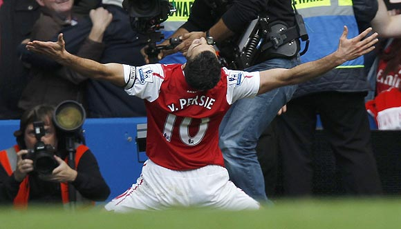 Van Persie celebrates after scoring his third goal