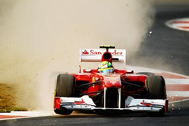 Felipe Massa of Brazil and Ferrari rides over the kerbs during the Indian Formula One Grand Prix