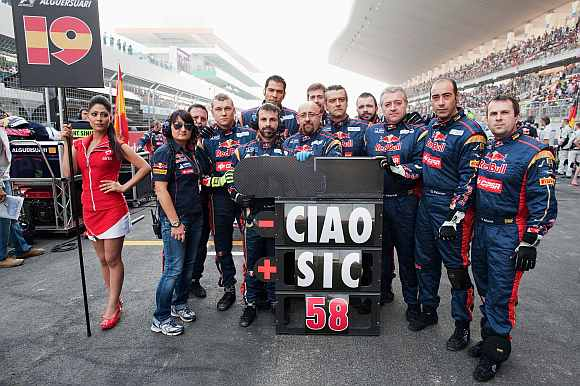 Scuderia Toro Rosso team pay their respects to Italian Moto GP rider Marco Simoncelli