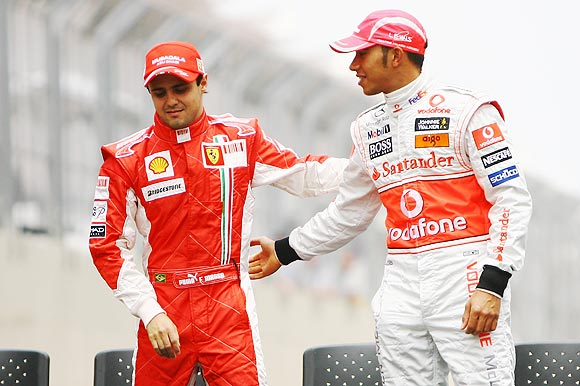 Lewis Hamilton of Great Britain and McLaren and Felipe Massa of Brazil