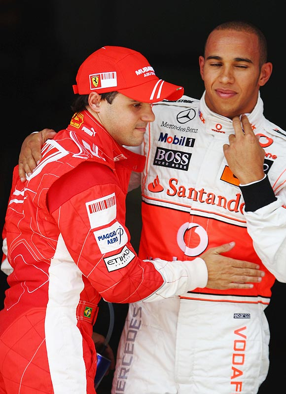 Felipe Massa (left) of Brazil and Ferrari celebrates in parc ferme with Lewis Hamilton
