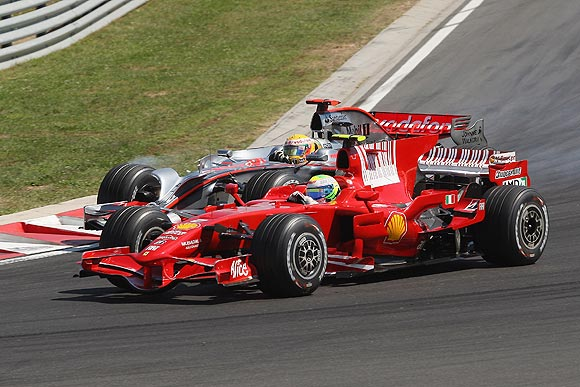 Felipe Massa of Brazil and Ferrari goes past Lewis Hamilton of Great Britain