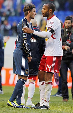 David Beckham of the Los Angeles Galaxy and Thierry Henry (right) of the New York Red Bulls
