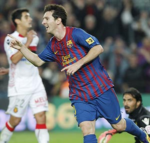 Lionel Messi celebrates after scoring against Real Mallorca