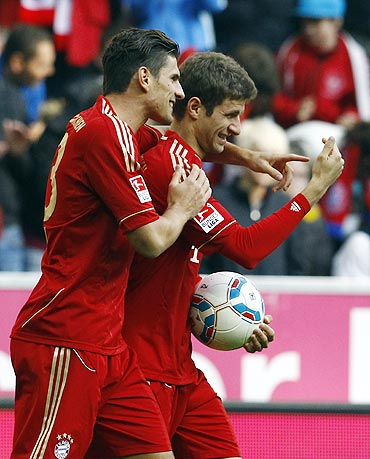 Munich's Mario Gomez and Muller celebrate a goal