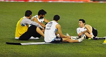Lionel Messi relaxes after a practice session