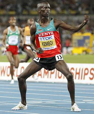 Ezekiel Kemboi celebrates after winning the 3,000 metres steeplechase