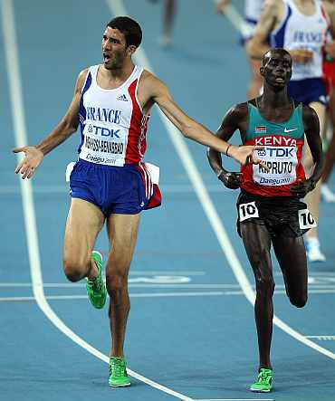 Mahiedine Mekhissi-Benabbad (L) of France reacts next to Brimin Kiprop Kipruto of Kenya after claiming bronze