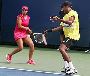 Mahesh Bhupathi and Sania Mirza in action against Lucie Hradecka and Frantisek Cermak during their mixed doubles match on Thursday